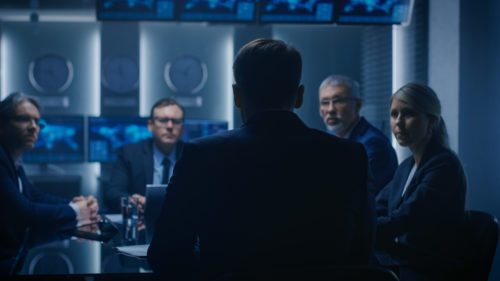 Chief Strategy Officer Making Report to a Board of Directors During Annual Financial Meeting in the conference Room. Business People / Politicians / Government Officials on a Meeting.